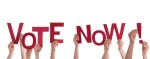 Many People Holding the Red Words Vote Now, Isolated