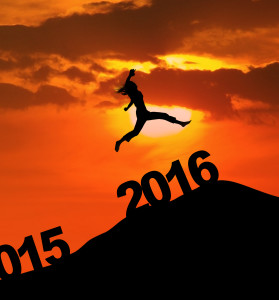 Photo of silhouette woman leaps on the hill above numbers 2016 at dusk time. New year concept